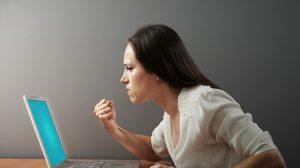 angry-woman-at-computer